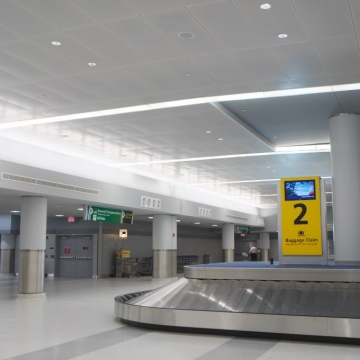 Perforated Metal Ceiling in Baggage Claim Area