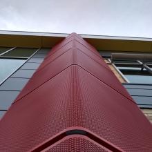 Perforated Radius Forming Facade